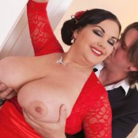 Black-haired big hot woman Nila Mason releasing large fun bags before delivering blowjobs in nylons