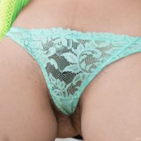 Brunette Bellavitana sliding underwear over adorable tush to uncover fur covered cooter