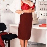 Brown-haired businesswoman Big-titted BriAnna flashes her fine legs and hefty funbags at once