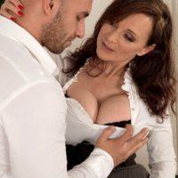 Dark haired cougar Michaela O'Brilliant having gigantic tits revealed before giving oral job