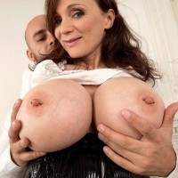 Brown-haired cougar Michaela O'Brilliant having large breasts revealed before delivering ORAL JOB