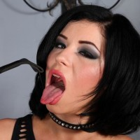 Dark-haired Bossy type Belle Noir vaunting lovely and trimmed muff in ebony spandex boots