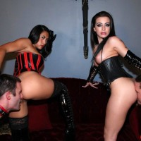 Dark-haired Dommes Adriana Lynn and Mia Li manhandle collared and nude dude subs