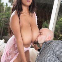 Dark haired ebony MILF Rachel Raxxx baring giant flappy hooters from transparent lingerie