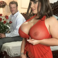Black-haired MILF Angel Gee exposing monster-sized tits from translucent dress for nip sucking
