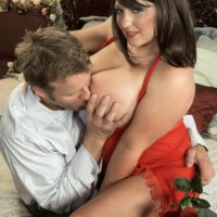 Brown-haired MILF Angel Gee freeing big knockers from transparent sundress for nip slurping