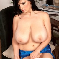 Brunette MILF Arianna Sinn sets her monster-sized tits free in sheer hose and high heeled shoes