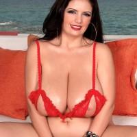 Brunette MILF Arianna Sinn sets her enormous tits loose of her releasing melon-holder