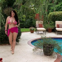Black-haired MILF Bex Shiner teasing non naked in poor swimsuit outdoors by swimming pool