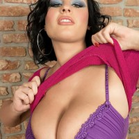 Dark-haired MILF Ivy Darmon sets her massive all natural hooters loose in solo action