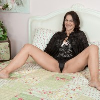 Dark-haired MILF Kaysy whipping out little tits and wide open coochie from seductive lingerie