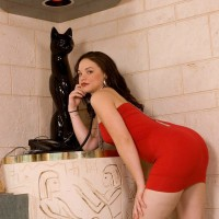 Dark-haired MILF Leenuh Kai revealing ideal butt and muff beneath red dress