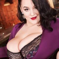 Brunette MILF Lila Payne releasing immense boobs in ebony garters and stockings