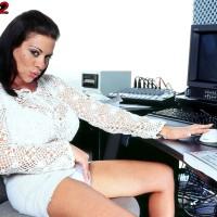 Black-haired MILF Linsey Dawn McKenzie unveils her hefty juggs at her work place desk