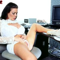 Black-haired MILF Linsey Dawn McKenzie unveils her hefty juggs at her work place desk