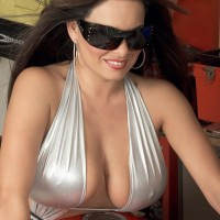 Dark-haired MILF Mia Starr unsheathing giant all natural melons on motorcycle in sunglasses