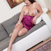 Dark haired MILF Monica Enjoy letting massive titties loose from bra and sundress in heels