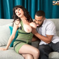 Brunette MILF over Fifty Karen Kougar seducing junior dude for sex on sofa