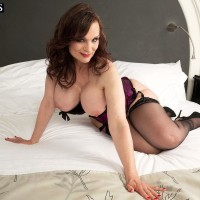 Dark-haired MILF over 50 Michaela O'Brilliant showcasing immense boobs before delivering BJ