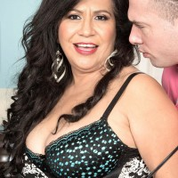 Black-haired MILF over 50 Victoria Versaci unsheathing huge ass while being stripped