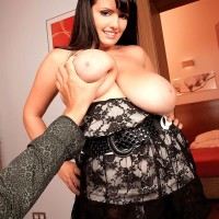 Brown-haired MILF XXX starlet Arianna Sinn uncovering hefty funbags before providing oral job