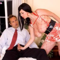 Black-haired MILF XXX starlet Terry Nova giving HJ and blowjob in fishnet body-stocking