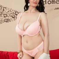 Dark haired MILF pornographic star Vanessa Y letting enormous all natural tits free in high heeled shoes