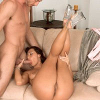 Dark-haired MILF Sandra Romain gags on a giant cock prior to doggy-style banging
