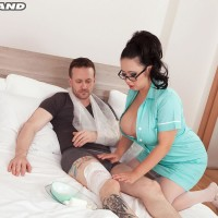 Dark-haired MILF Tigerr Benson loosing giant breasts before having sex on clinic bed