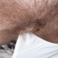Brown-haired porno starlet Baby Boom loosing unshaven snatch from white bloomers in nylons
