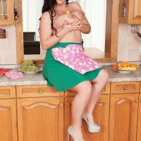 Dark haired stunner Juliana Simms letting enormous titties loose from sundress in kitchen