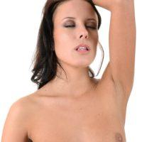 Dark haired babe Lexi Layo slides off her spectacular lingerie prior to masturbating