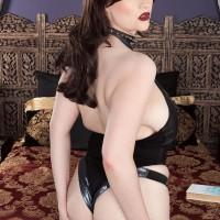 Black-haired solo female Tiggle Bitties kneads her huge boobs garbed ebony lingerie