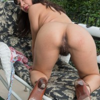Brown-haired solo female Vivi Marie vaunting furry underarms and spread slit outdoors