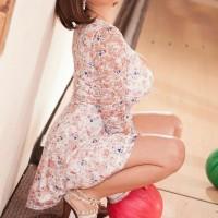 Brunette solo model Alexya letting nips slip from bra in bowling alley