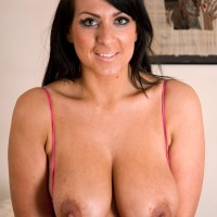 Huge-boobed amateur undresses a pink bodysuit before toying her cooter in matching pumps