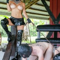 Busty blonde Domme Alexis Fawx leading two masked male submissives on leashes