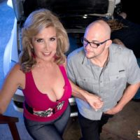 Busty light-haired cougar Laura Layne seducing mechanics for MMF threeway in garage