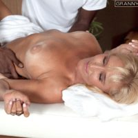 Busty fair-haired grandmother Brittney Snow has her breasts toyed with by her ebony massagist