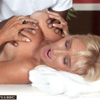 Big-titted sandy-haired grandmother Brittney Snow has her titties played with by her black massagist