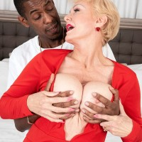 Buxom blond granny Seka Black holds a Peeping Tom's enormous black dick in her hand