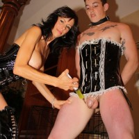 Bosomy dark haired mistress Alexis Faux having fantastic legs and cooch attended to by sissy maid