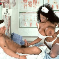 Chesty black nurse Angelique entices a masculine patient during upskirt activity on a bed