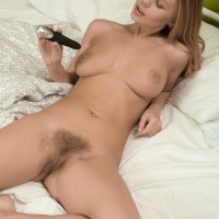 Huge-chested European first-timer Darina Nikitina toying wooly slit while masturbating
