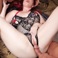 Big-titted ginger-haired MILF Heather Barron fucking TWO gigantic knobs during MMF three way