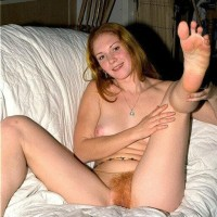 Caucasian amateur puts her ginger beaver on display while downright naked by herself