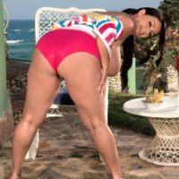 Chesty dark haired stunner Arianna Sinn flaunting immense boobs while slurping an ice cream cone