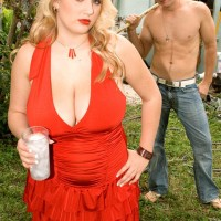 Plump sandy-haired babe Shyla Bashful revealing giant juggs and erect nipples outdoors