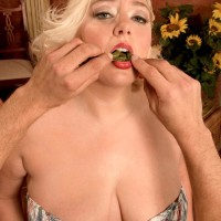 Round blonde girl Daphne Carter letting massive melons loose while licking food and providing BLOWJOB