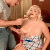 Round sandy-haired female Daphne Carter letting huge boobs free while munching food and providing BLOWJOB